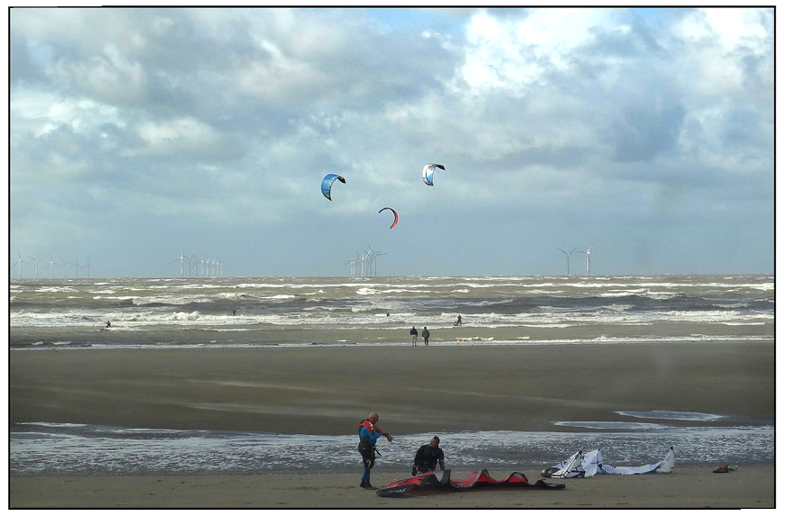 Wind surfers and beach